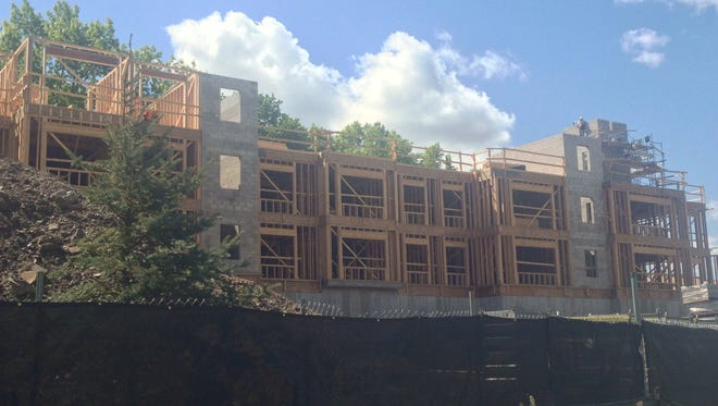 56 apartments and 9,000 square feet of retail pictured under construction in Wallington.