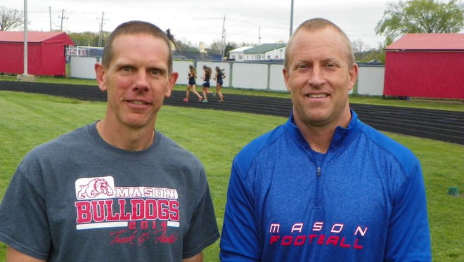 Mason girls track and field coaches David Jones, left, and Jerry VanHavel, right,  recently earned their 100th coaching victory together.