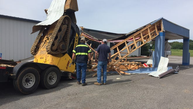 The canopy was torn off the front of Priceless Jewels Academy at 1086 Lafayette Road on Monday morning after a trailer came off an SUV and a stolen skid loader toppled off.