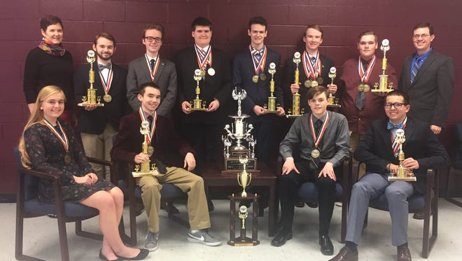 The Henderson County High School state champion Governor's Cup team poses with its awards and trophies for a photo to be used for a banner to hang at the high school as well as a billboard celebrating the accomplishment.