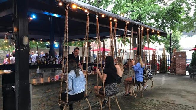 Swings at the bar at Treehouse Patio Bar.