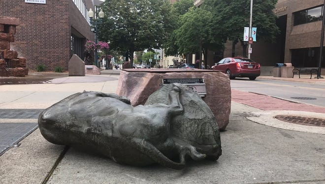 Sculpture outside Phillips Avenue Diner was knocked down Saturday.