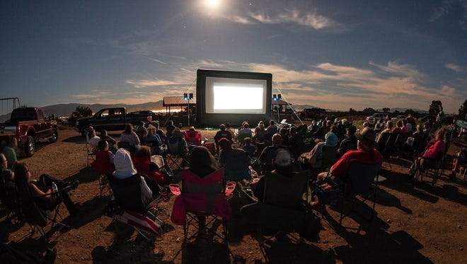 Attendees watch a documentary at the annual Utah UFO Fest.