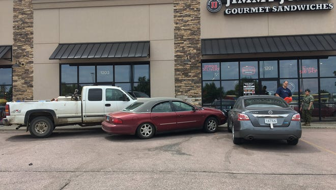 A vehicle on a tow truck came loose and crashed into two other vehicles and a Jimmy Johns Saturday, June 10.