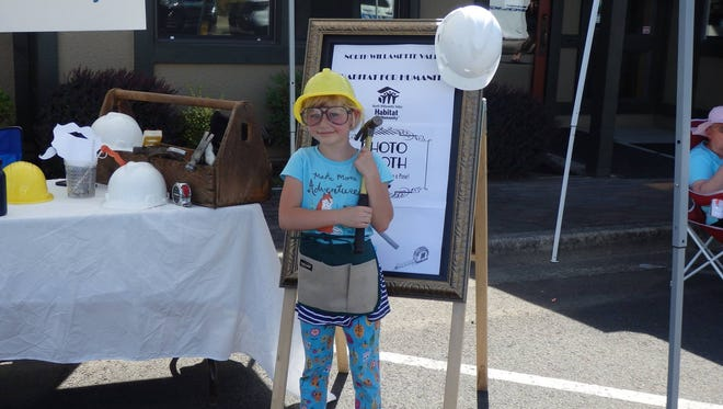 Having fun at the Habitat for Humanity exhibit during Mt. Angel Telephone Customer Appreciation Day, 2016. This year DirectLink is holding Summer Celebration in lieu of the appreciation day, but expects a number of nonprofit informational booths to once again be a part of the event.