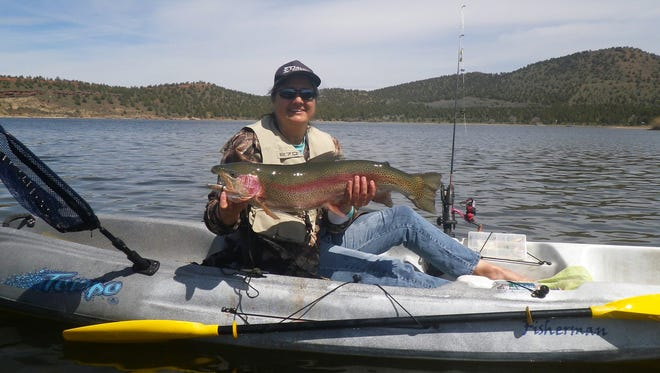 Erika Forsythe with her 11-pound trophy trout taken in Haystack Reservoir in April 2017.
