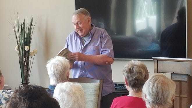 """Former Wisconsin Governor Martin Schreiber shares excerpts of his book """"My Two Elaines: Learning, Coping, and Surviving as an Alzheimer's Caregiver"""" at Shady Lane Nursing Care Center in Manitowoc June 27."""