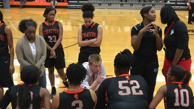 New Sycamore High School Girls Basketball Coach Cody King talks to his former team at Stratford High School during a game.