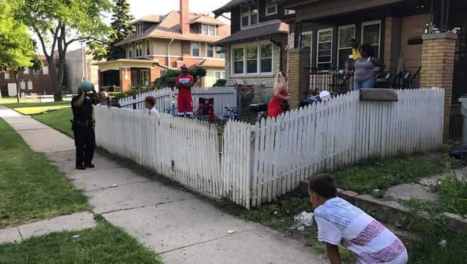 Police play a game with a 10-year-old on the 4th of July