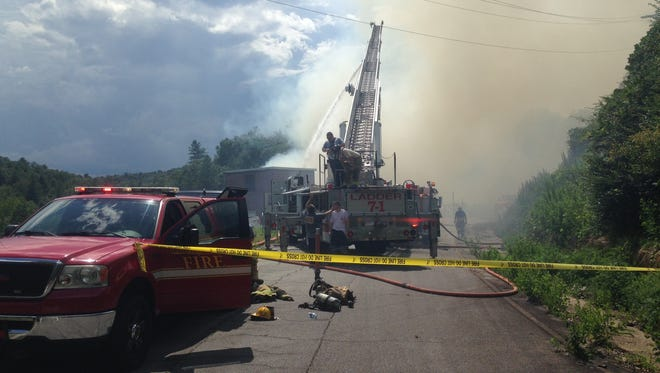 Fire crews attempt to contain a blaze at the old Cateechee Mill near Norris Thursday.