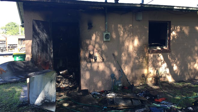 House charred by fire in Central Brevard.