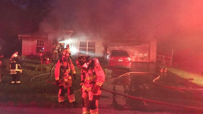 Palm Bay firefighters responded Monday night to a fire on Glenridge Street NW. A woman was flown to a hospital with non-life threatening injuries.