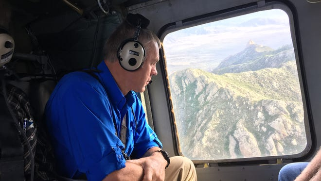 U.S. Secretary of the Interior Ryan Zinke looks out the window of a helicopter during a tour of the Organ Mountains and surrounding areas Thursday, July 27, 2017.