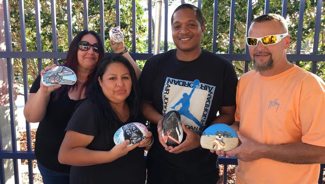 Port St.Lucie Rocks donated five Star Wars-painted rocks to the Boys & Girls Clubs of St Lucie Countyfor fundraising purposes. From left are Melissa, Carmen Molina, Chris Jackson, and Jon Lecanu.