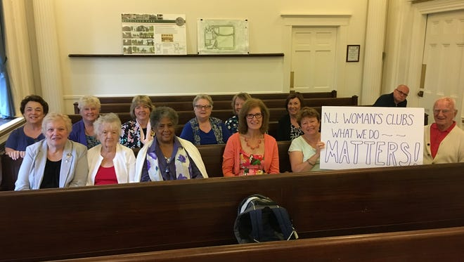 Thirteen members of the New Jersey State Federation of Women's Clubs of GFWC attended the New Brunswick City Council Meeting on  Aug. 2, when they were presented a resolution in recognition of the 100th anniversary of their founding of The New Jersey College for Women, now known as Douglass Residential College.