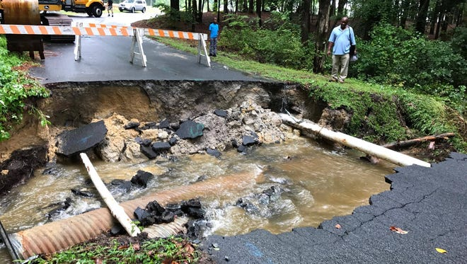Bell Island Trail in Harbor Point/Cotton Patch, off Pemberton Drive in Salisbury, is washed out after flooding on Saturday, Aug. 12.