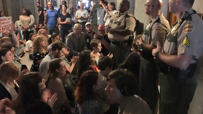 Protesters block the door to Gov. Bill Haslam's office during a rally against a Nathan Bedford Forrest bust at the state Capitol.