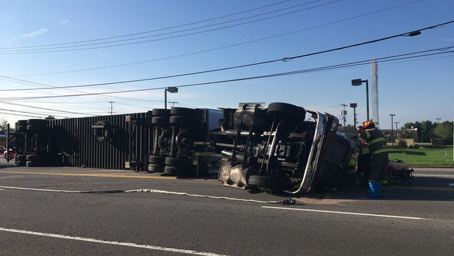 A tractor trailer overturned at Trenton and Tiny Town Roads Wednesday.