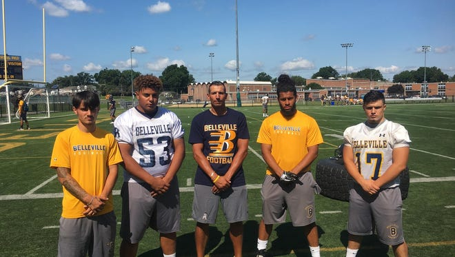 Belleville High football captains, left to right, Jeff Mayer, Mahmoud Youssef, Gustavo Viana and Gabe DiPalma flank head coach Mario Cuniglio (center).