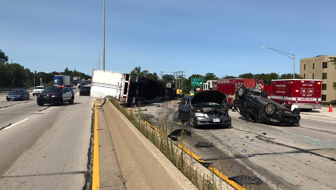 A semitruck rolled over and multiple vehicles were damaged in an accident that closed northbound and southbound lanes of I-43 on Sept. 1.