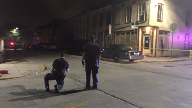 Police photograph the scene of a reported shooting in the 400 block of South Duke Street in York Wednesday night.