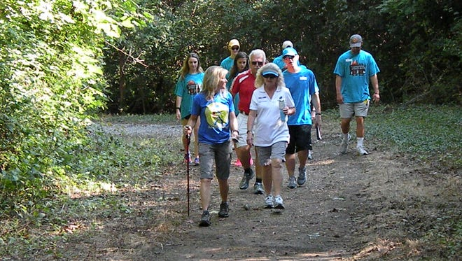 "Missy Kane, front left, has been encouraging people to hike for 20 years through her ""Get on Trails"" program."