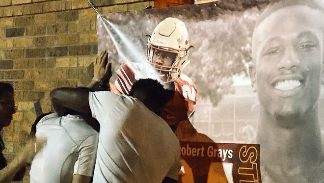 MSU students met and prayed for injured football player Robert Grays Monday night. The sophomore from Houston suffered a neck injury in Saturday's game at Memorial Stadium.