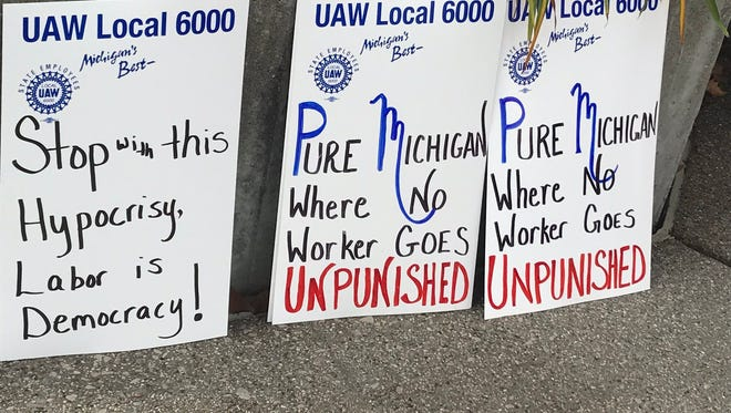 Scenes from rally before Michigan Civil Service Commission vote expected to curtail state worker collective bargaining.