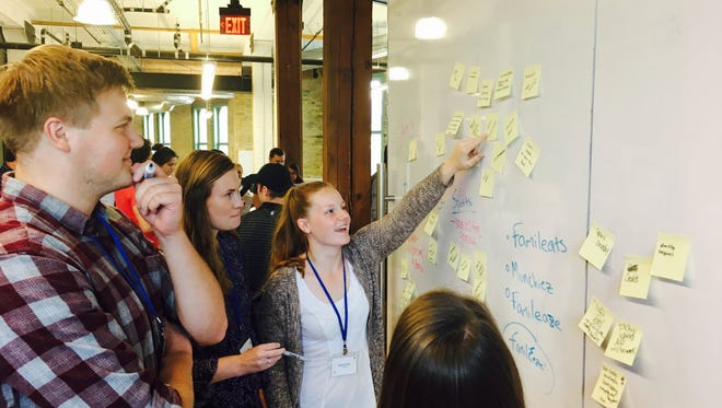 Students brainstorm ideas during The Commons in Milwaukee. The innovative program that pairs students with local business leaders may expand into the Sheboygan area.