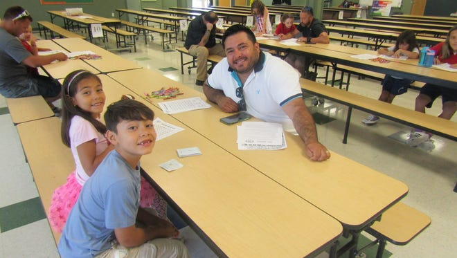 Being involved with your children's lives and presenting a positive role model is what WATCH D.O.G.S. is all about. Dad Henry Silva and children Santiago and Sophia are happy to hang out together.