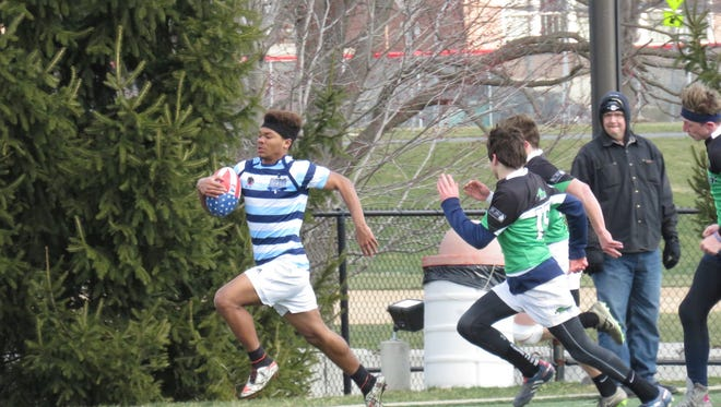 Kory Harris sprints past a defender.