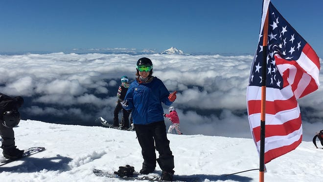Former Aztec resident Brittani Coury, seen in this file photo, won a silver medal Friday for snowboarding in the Women's Banked Slalom competition during the 2018 Winter Paralympic Games in PyeongChang, South Korea.