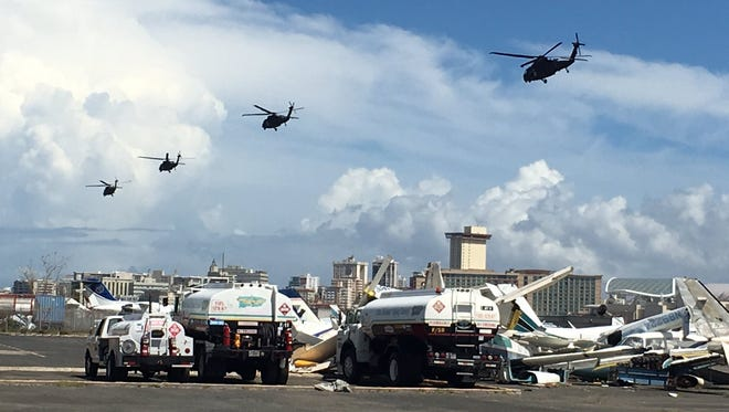 Four HH-60 medevac Blackhawk helicopters from the 101st Combat Aviation Brigade, 101st Airborne Division depart Fernando Luis Ribas Dominicci Airport, Sept. 29.