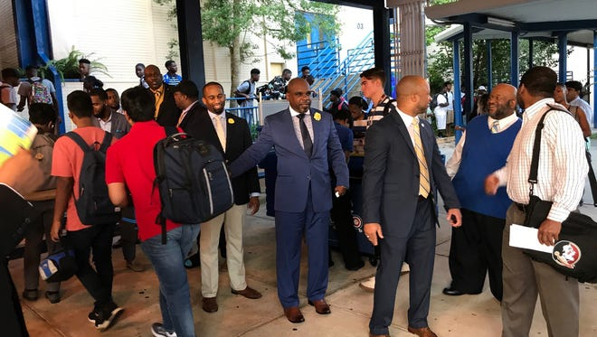 The Kingsman Club started with founder Marvin Boatman's idea to greet Rickards High students and wish them well in the academic year on the first day of school.