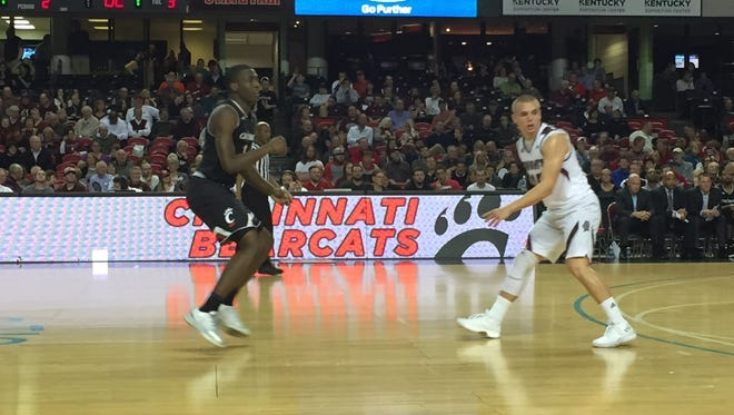 University of Cincinnati freshman guard Keith Williams (left) and Bellarmine freshman guard CJ Fleming (La Salle High School) in action during Wednesday night's exhibition game at Louisville's Freedom Hall.