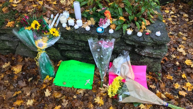 Flowers, candles and prayers are left at the site where Jason Spencer was killed.
