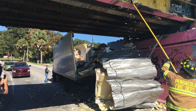 A truck was significantly damaged Thursday, Nov. 16, 2017, after authorities said the driver misjudged the height of the Graffiti Bridge while passing underneath it.