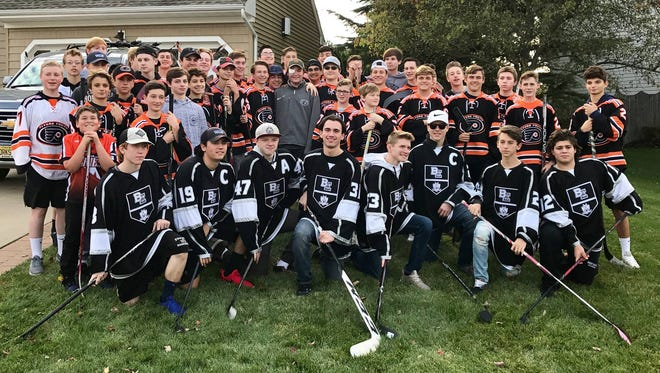 Maison Houser, center, returned home after a week-long hospital stay to remove his right eye and many teammates from three different teams were waiting for him.