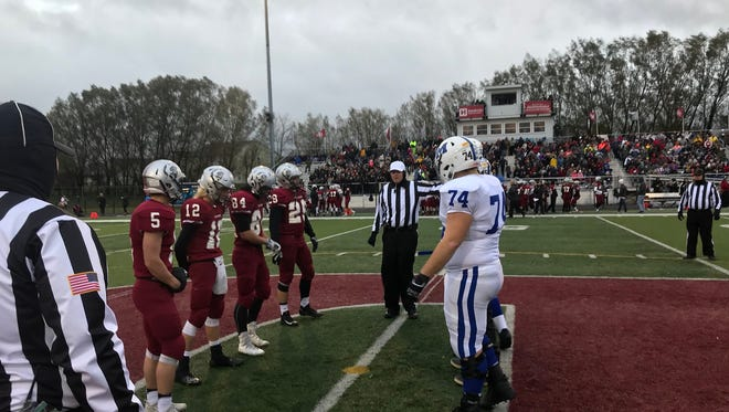 Memorial and Danville captains line up for the coin toss before the Class 3A semistate game.