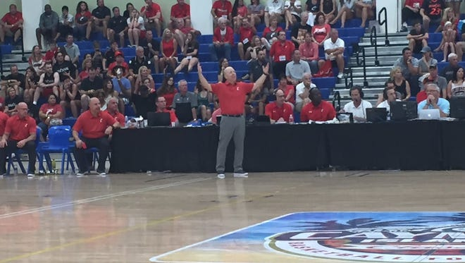 University of Cincinnati coach Mick Cronin endured a stressful night Monday, as the No. 12 Bearcats held off upset-minded Buffalo 73-67 in the Cayman Islands Classic.