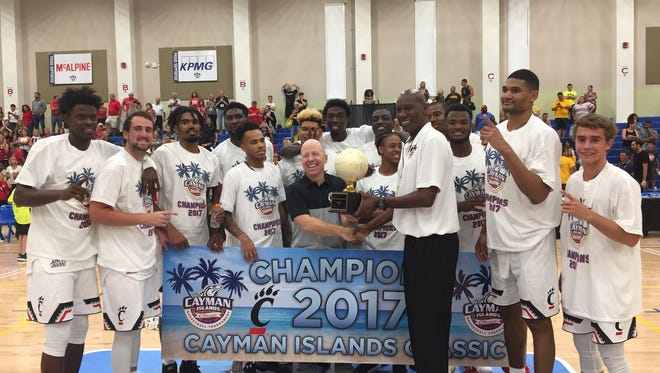 Coach Mick Cronin and the Cincinnati Bearcats celebrate their Cayman Islands Classic championship Wednesday night. The No. 12 Bearcats return home to play Alabama State on Nov. 27, followed by the Crosstown Shootout at Xavier on Dec. 2.