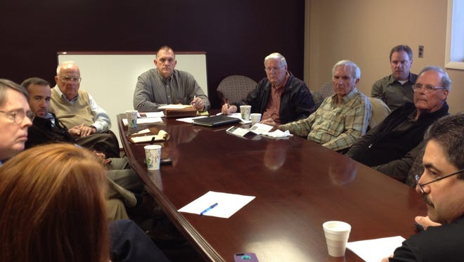 The Springfield-Robertson County Airport Board is pictured with  Sam Chitty at the head of the table.
