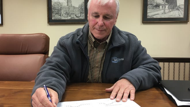 Clarksville Gas & Water Director Pat Hickey crunches the numbers as the department looks to restructure natural gas rates.