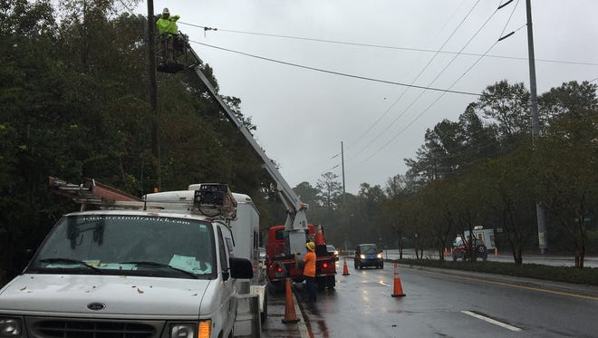 Many businesses are without phone and internet services after a semi-truck hit a low-hanging fiber optic line, pulling down a power pole with it.