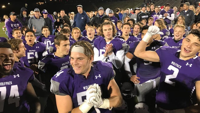 Shasta football team celebrates after beating Marin Catholic Saturday for a shot at the state title.