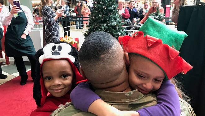 Lily Marshall got a special Christmas present from Santa, the chance to reunite with her father who serves overseas.