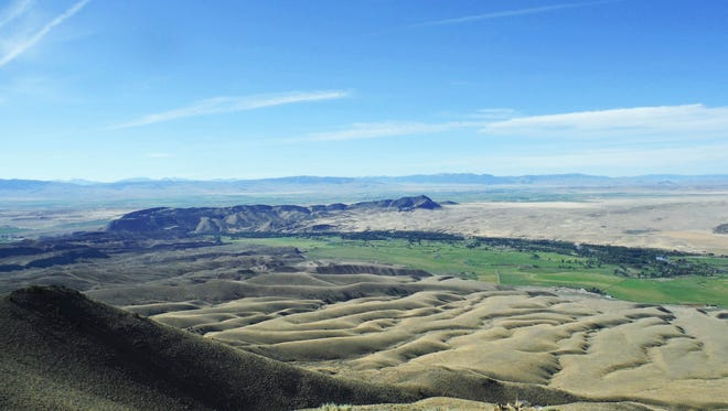 A southeast view of Hogback Mountain (center-left) in Madison County shows where Meriwether Lewis and George Drouillard climbed  on August 5, 1805 for a view of today's Big Hole, Ruby and Beaverhead rivers.