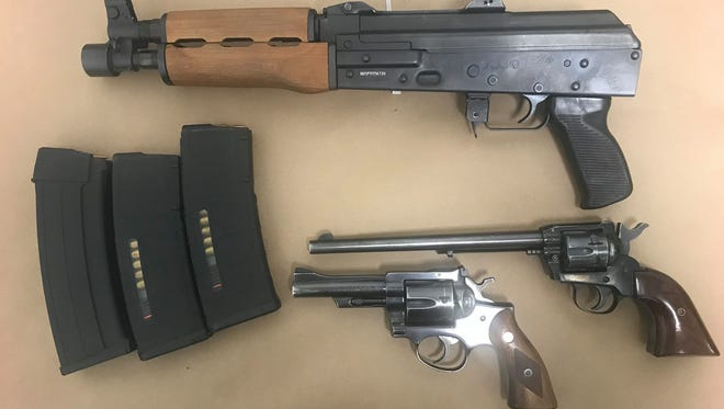 A probation search yielded multiple arrests including the recovery of three firearms.