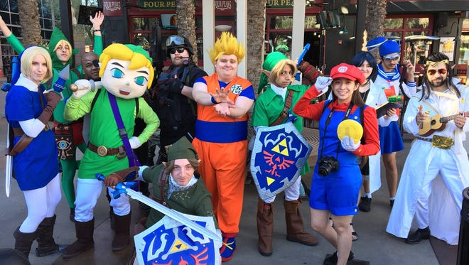 A group of colorful cosplayers pose for a photo outside Gila River Arena in Glendale Saturday, Jan. 13, 2018.