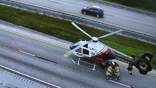 A helicopter flies a patient to a hospital after a crash on the turnpike on Dec. 13.